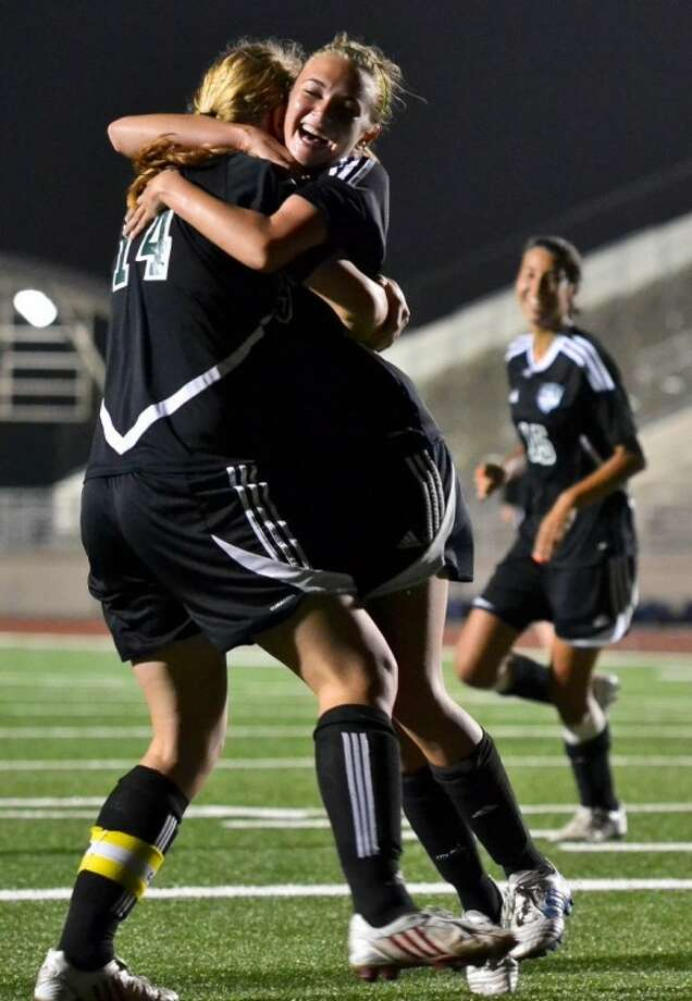 Kaitlyn Boucher (14) and Maranda Gerga celebrate following Gerga's goal in the second half of Kingwood Park's area-round playoff game against Friendswood April 3 at Turner Stadium.