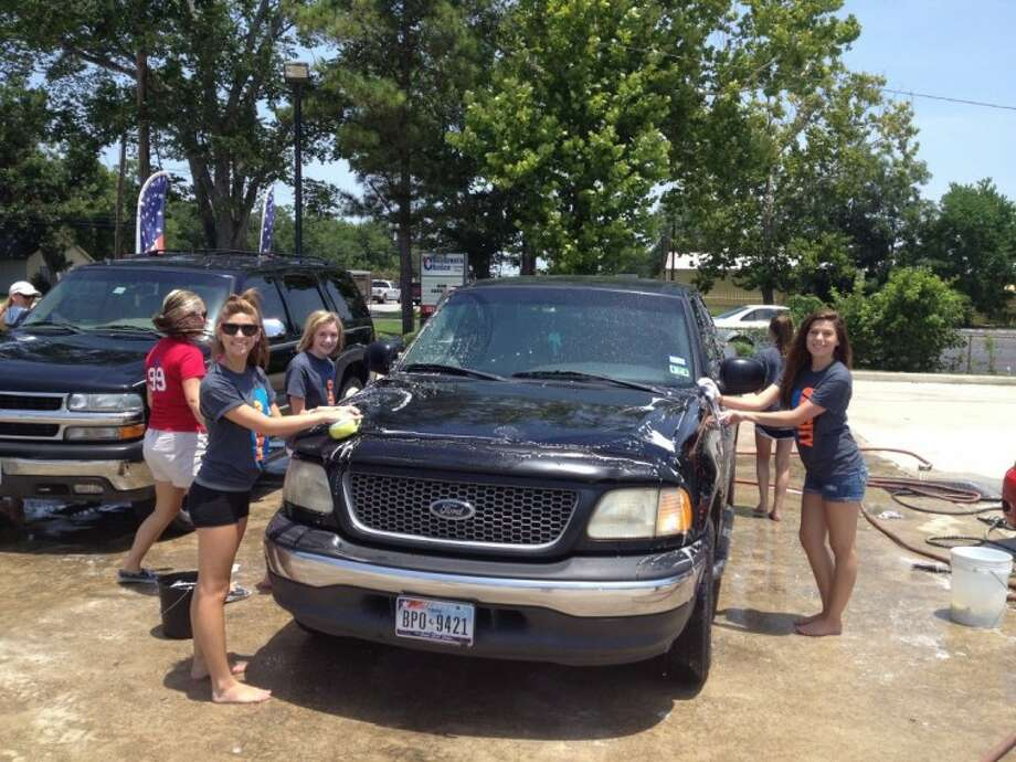 The Dawson High School Cheerleader Booster Club raised more than $1,900 at a car wash held at Gates Used Cars Saturday (July 27).