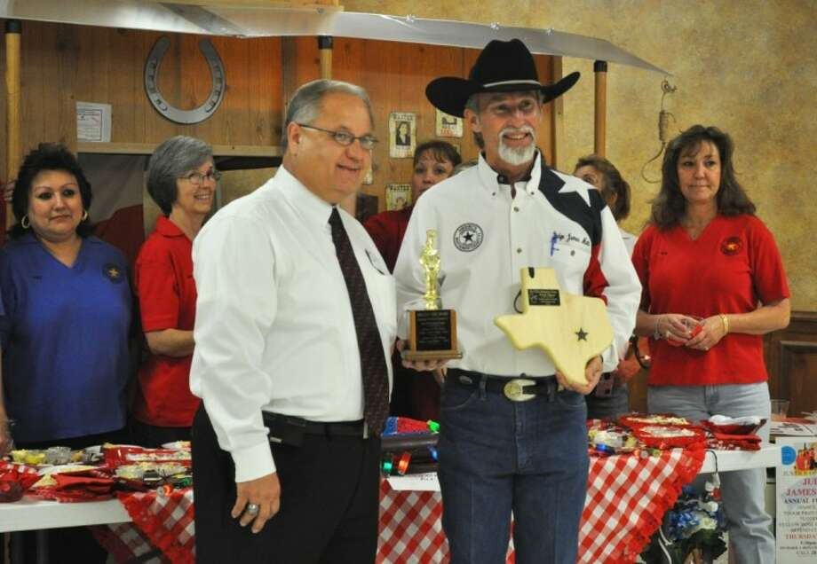 Justice of the Peace James Metts, right, accepts the plaque for winning first place in the best booth category at last year's Taste of EMC event. Segrest Realty came in second, and Constable Rowdy Hayden's booth took third.
