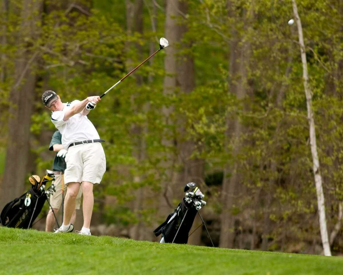 Immaculate High's Brian Herlihy hits a drive off the second tee during an SWC match against New Milford Wednesday at Richter Park Golf Course in Danbury.