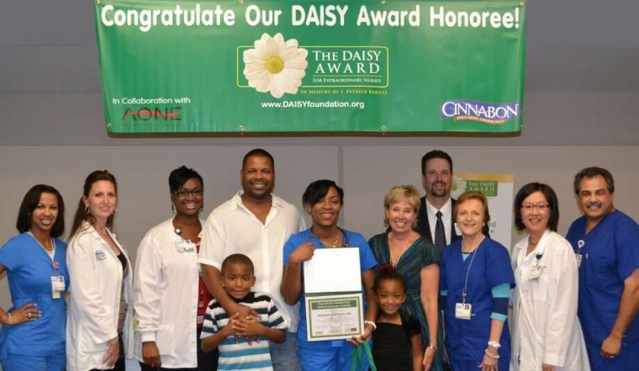 DAISY Award Recipient Keisha Guzman (center) with her family and the DAISY Award Committee.