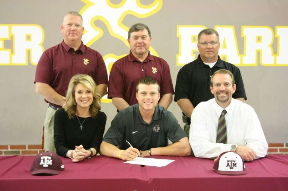Deer Park High School senior Logan Taylor signs a baseball scholarship with Texas A&M Wednesday morning. Pictured with Logan are back row: assistant coach Chris Cauley, head coach Emerick Jagneaux, assistant coach Darren Schneider, and parents Lori and Kirk Taylor.