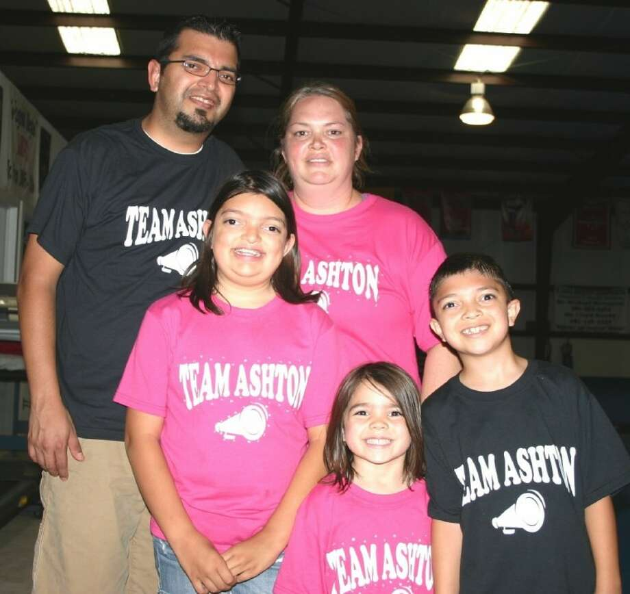 Jason and Jennifer Banda attend the Team Ashton fundraiser April 28 at Lake Houston Platinum Cheer with their children, from left, Ashton, Drew and Benjamin. Primarily through a silent auction, a crawfish boil and the on-site sales of Team Ashton T-Shirts, hundreds helped to raise funds for the family's medical-related travel expenses as Ashton in June will undergo a second surgery in Dallas to correct the effects of two rare conditions.