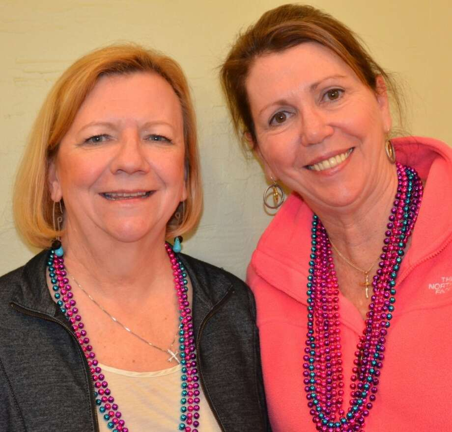 "Assistance League Fundraising Chairman Jill Williams, right, huddles with Vice Chairman Peggy Heinrich as they plan their big annual benefit, ""Feast: A Night on Bourbon Street,"" which will be held at the Hobby Marriott on the Gulf Freeway Saturday, April 14."