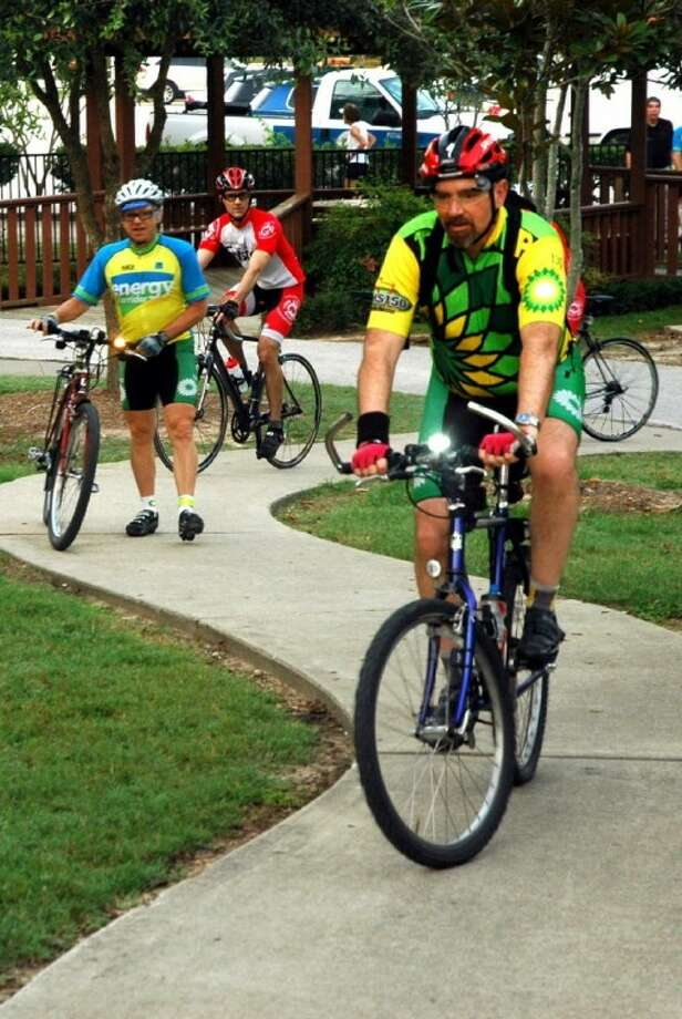 Cyclists arrive for breakfast, music and prizes at Terry Hershey Park.
