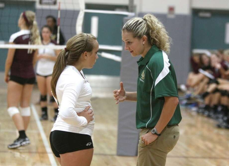 Fort Bend Christian Coach Heather Kisner Talks With Junior Alex  Diefenderfer During The Remedy Roofing Volleyball