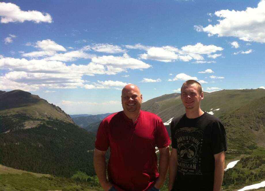 Roy Wooten, executive director of Cypress-based nonprofit Shield-Bearer Counseling and a father of two, spends time with his son Blake on a trip to the Rocky Mountains.