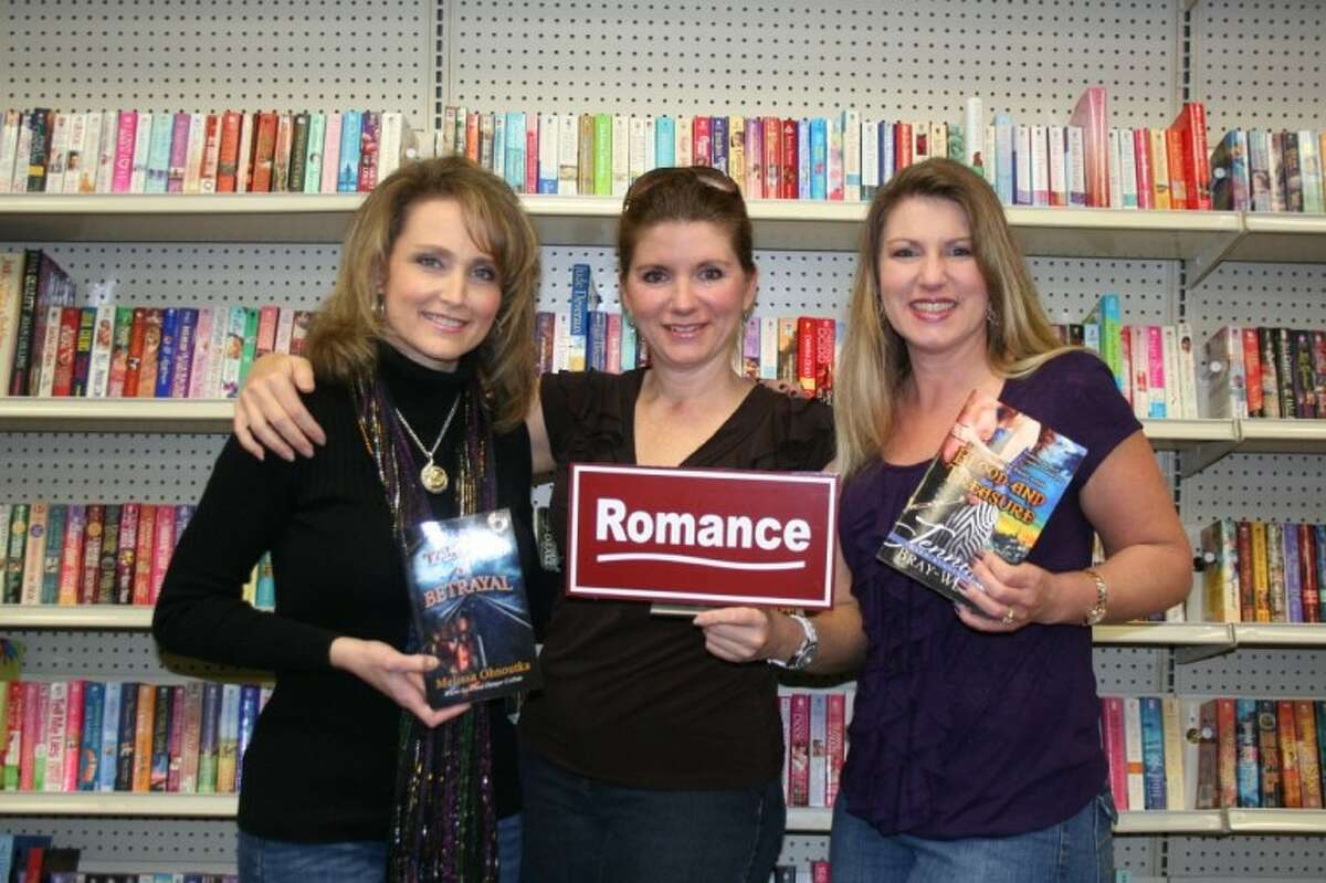 Melissa Ohnoutka, author of Target of Betrayal, vice president Stacey Purcell and president Jennifer Bray-Weber, author of Blood and Treasure, found friendship and encouragement through the Northwest Houston Romance Writers Association.