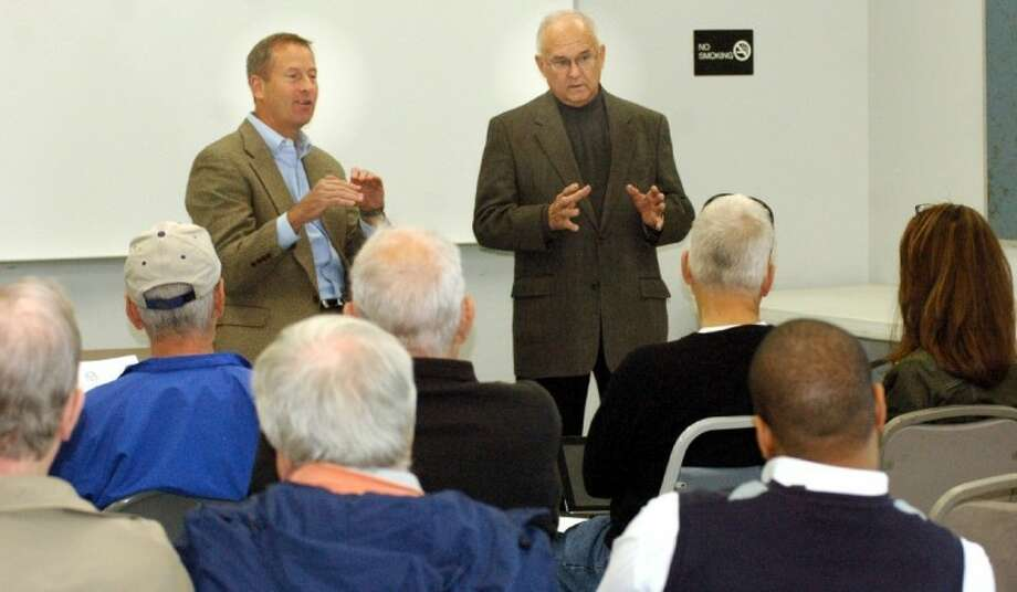 From left, state Reps. Jim Murphy (R-133) and Bill Callegari (R-132) answer a question Saturday during a town hall meeting at Glen Cheek Education Building.