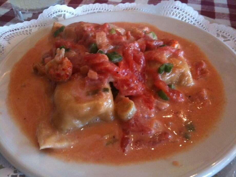 The generous crawfish filling with its hint of poblano is quite tasty in the Crawfish Ravioli at D'Amicos Italian Market. Tanji Patton said the creamy fresh tomato sauce is so good you'll want to lick it right off the plate!