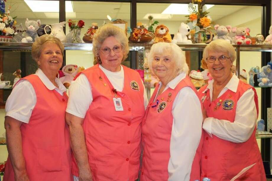 Volunteers from the Cleveland Regional Medical Center Gift Shop donate over 250 Christmas gifts to the foster children of Liberty County. Pictured left to right are Delores Mathew-Burt, Lavelta Simmons, Vivian Vann and Betty Bell. Not pictured is Madie Jones. Photo: STACEY GATLIN