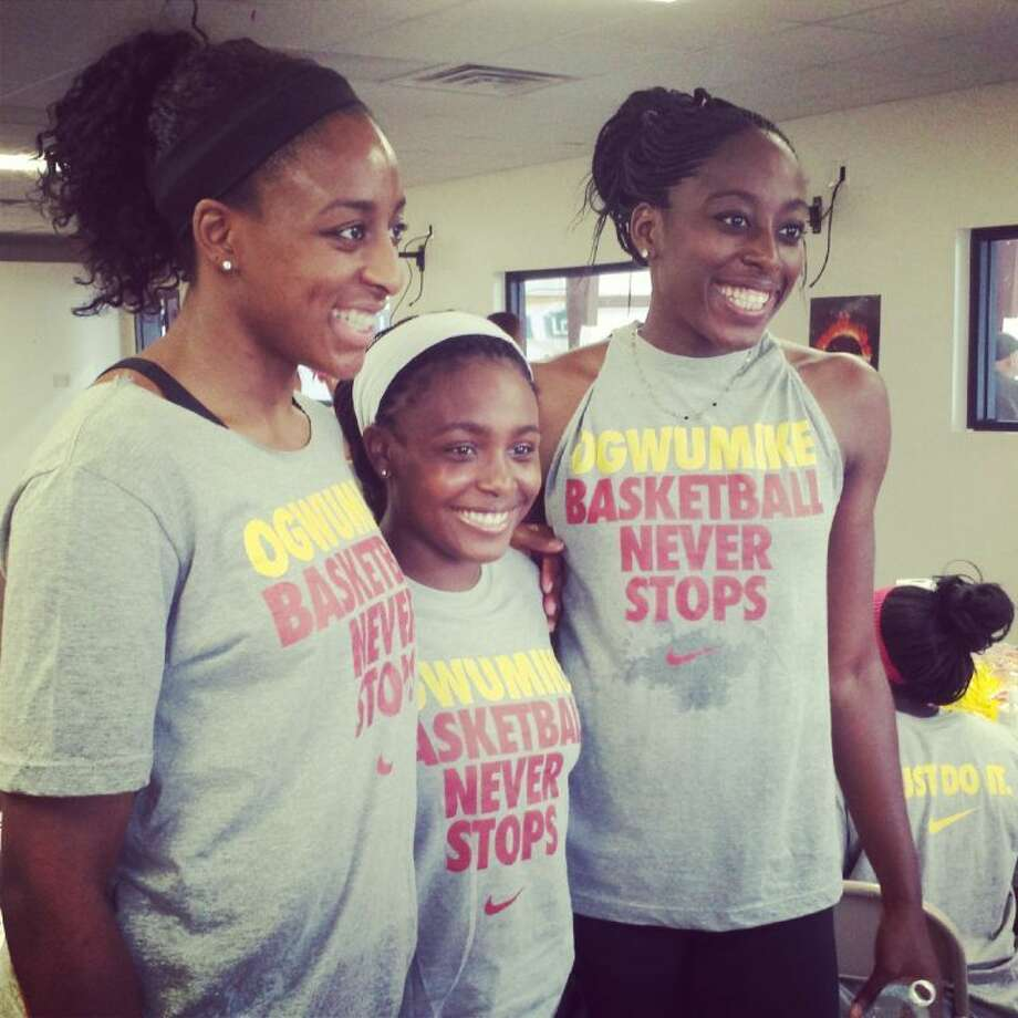 Nneka (left) and Chiney (right) pose for pictures at a basketball camp in September. The family continues to be involved in giving back to the Cypress community. Photo: ADAM COLEMAN