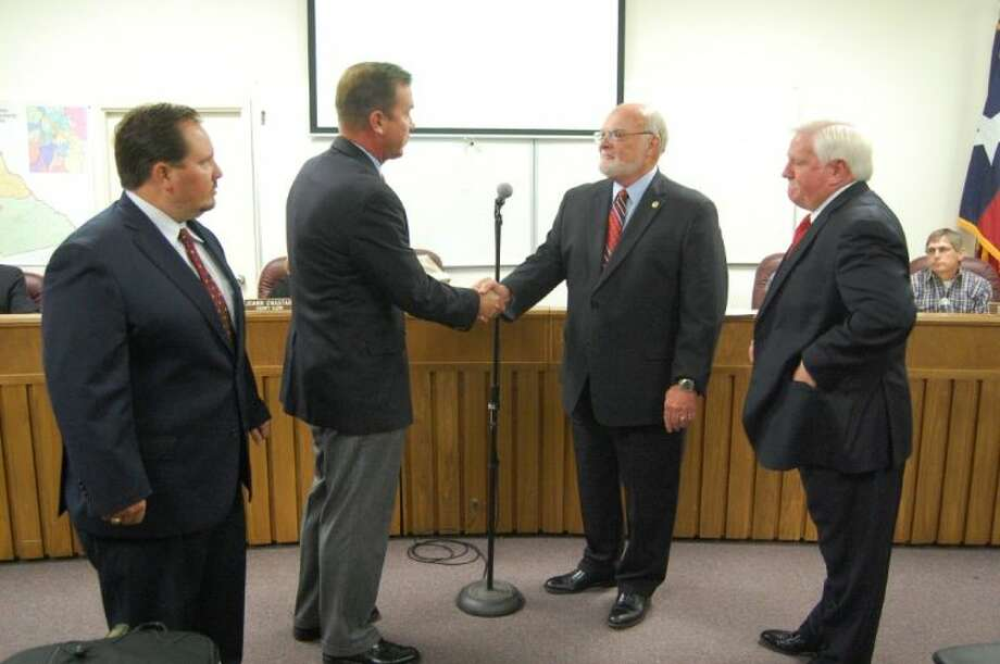 Senator Robert Nichols accepts an award from the Texas Association of Counties for being named a 'Friend of County Government.' Pictured left to right are Rick Thompson, Paul Sugg, Sen. Nichols and Angelina County Judge Wes Suiter. Photo: Submitted Photo