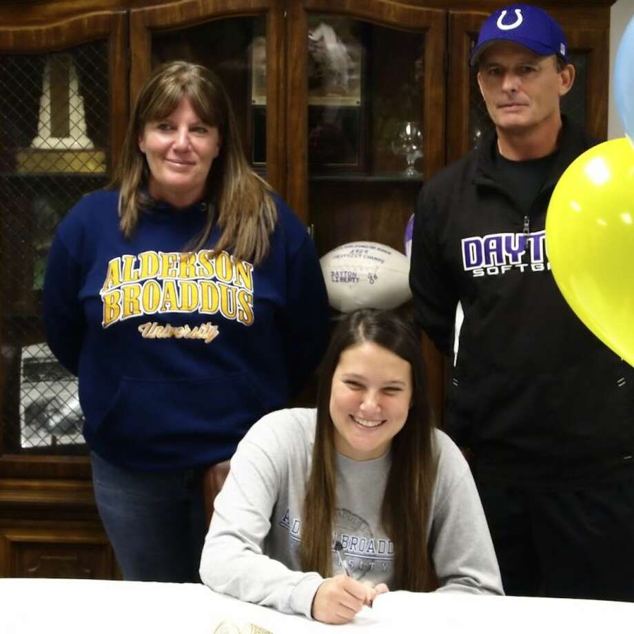 Dayton High School senior and center fielder Dixie Vernueil signs with Alderson Broaddus University in West Virginia on Friday, Nov. 15. Shown with Dixie are her mother, Kelly Rice, and Coach Daryl Bell. Photo: CASEY STINNETT