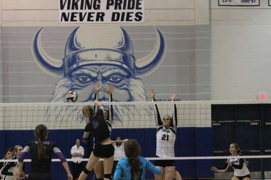 Mary Pettibon (5) from the College Station Lady Cougars attacks the net and gets the game point in the fourth game against the Lady Horns. The Lady Cougars advance to the final four of the region. Photo: SEAN ASHLEY JONES