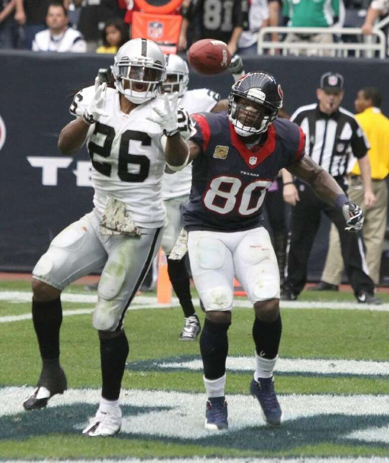 Oakland Raiders Usama Young almost intercepts pass intended for Houston Texans Andre Johnson in the endzone to end the Texans last drive at Reliant Stadium in Houston. Photo: Photo By Alan Warren