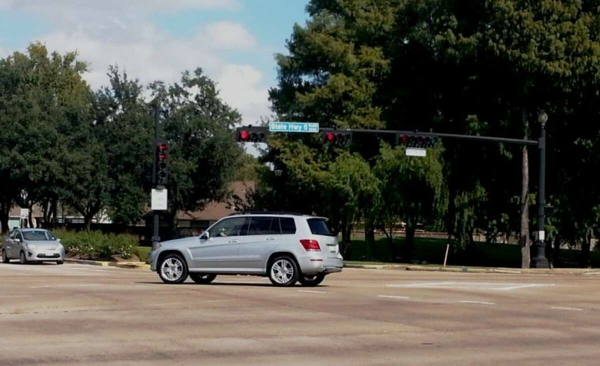 A driver - who should receive a $75 notice of violation shortly - blows through a red light while turning left onto Highway 6 from Lexington Boulevard.