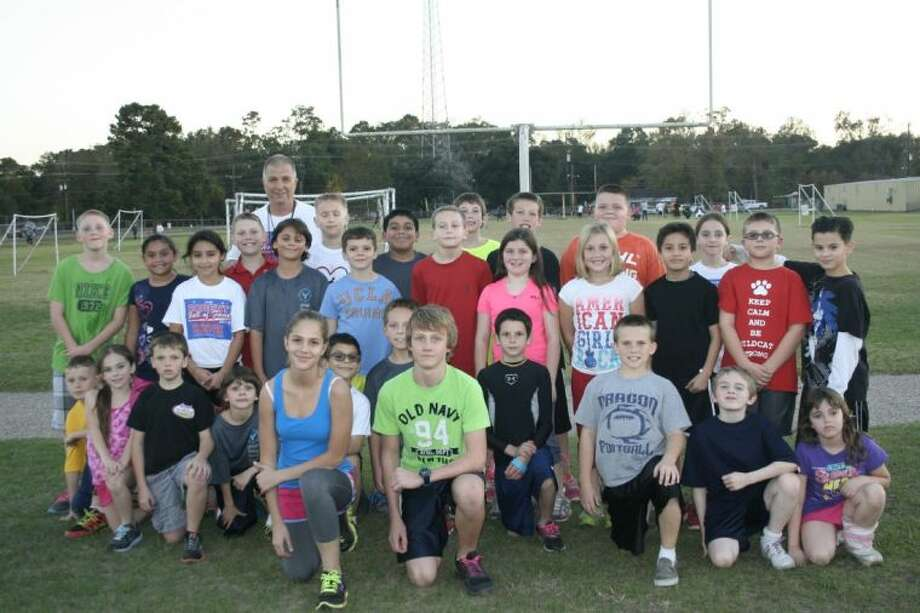 The Splendora Youth Running Club, under the direction of Coach Bill Horewitch at Greenleaf Elementary, meet twice weekly and dedicate countless hours to their sport. Photo: STEPHANIE BUCKNER
