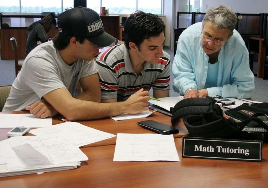Students work with tutors in the Learning Lab in this ACC file photo.
