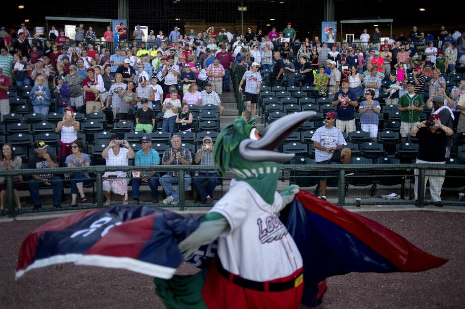 FILE - Lou E. Loon spins around with the Midwest League Championship flag after the Great Lakes Loons won the  championship series at Dow Diamond September 18. This is the first time in the team's 10-year history that they won the league title. Photo: Brittney Lohmiller/Midland Daily News