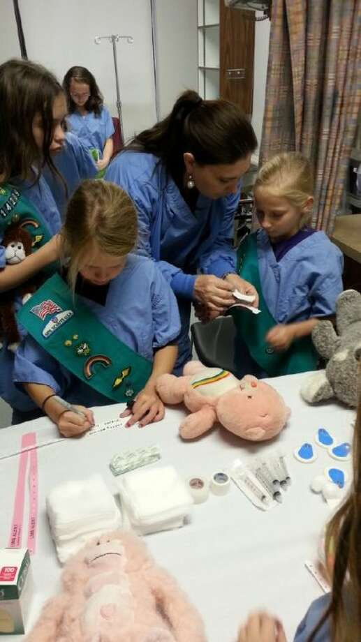 Junior Girl Scout Troop 14269 from Tomball toured the E.R. and learned about topics including hand washing, blood pressure and infection control. The girls and their stuffed animals participated in a Teddy Bear Clinic and earned their junior first aid badge. Photo: Submitted