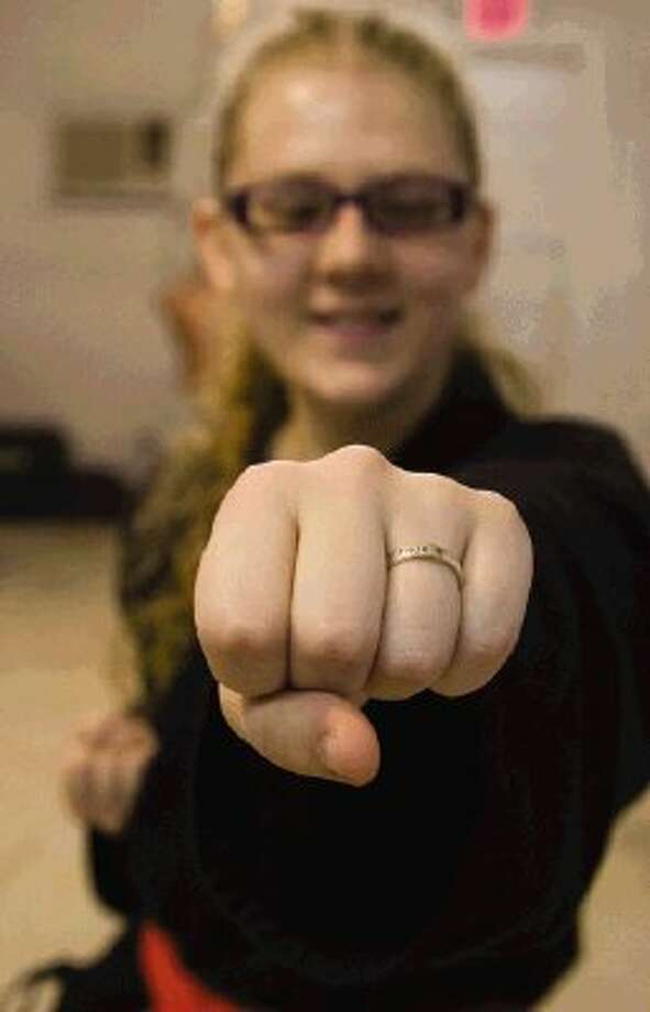 Amber Lester, an orange belt in shotokan karate, is pursuing her black belt in martial arts although nearly blind. Photo: Staff Photo By Ana Ramirez / The Conroe Courier