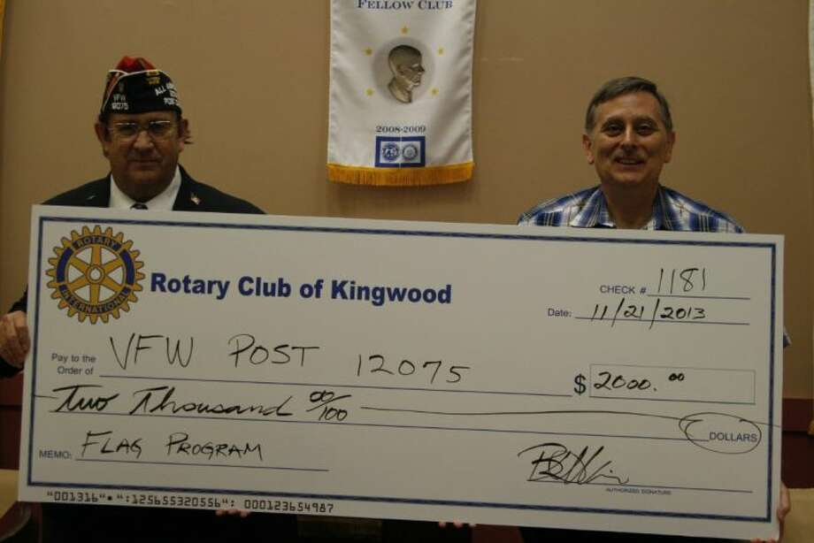 The Kingwood Rotary Club donated $2,000 to the VFW Post 12075 for their help with their Flags Across Kingwood program.