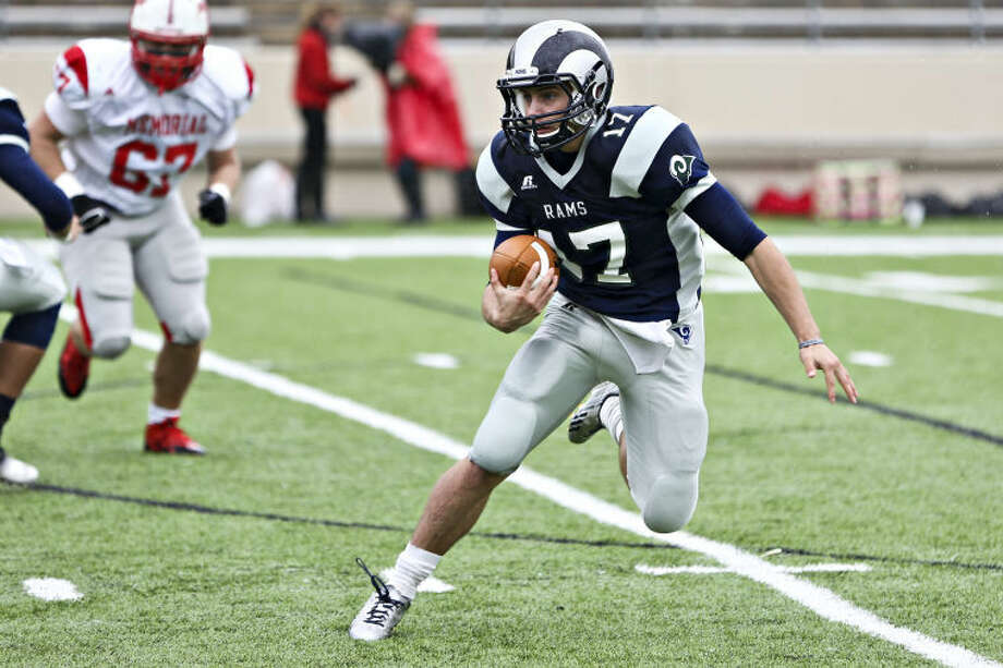 Cy Ridge's Garrett Penascrambles during the game against Memorial on Saturday at Pridgeon Stadium. To view or purchase this photo and others like it, go to HCNPics.com. (Michael Minasi / HCN) Photo: Michael Minasi