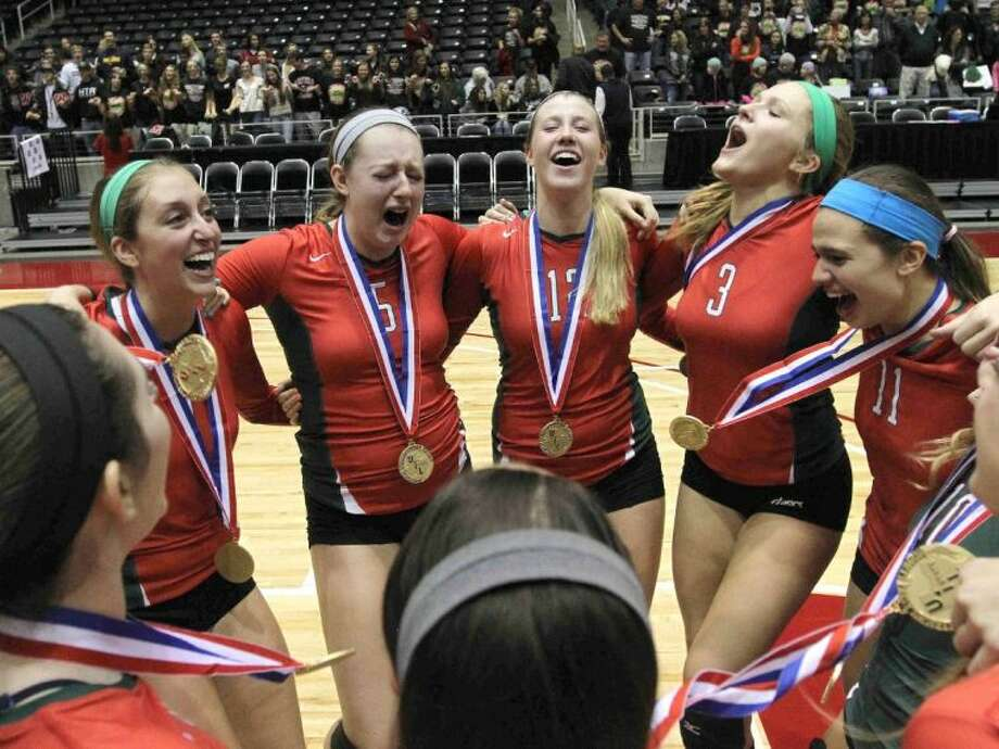 The Woodlands volleyball team celebrates after defeating San Antonio Churchill in straight sets to win the Class 5A UIL Volleyball State Championship in Garland. To purchase this photo and other like it, visit HCNPics.com. Photo: Staff Photo By Jason Fochtman