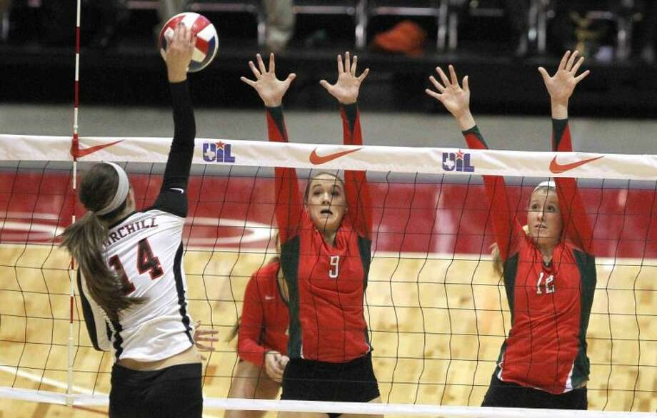 The Woodlands' Courtney Eckenrode (9) and Rachel Reed (12) go up to block a shot by San Antonio Churchill's Abby Buckingham during a Class 5A UIL Volleyball State Championship game Saturday in Garland. The Woodlands defeated San Antonio Churchill in straight sets to became the 18th undefeated volleyball state champion in UIL history since 1967. To purchase this photo and other like it, visit HCNPics.com. Photo: Staff Photo By Jason Fochtman