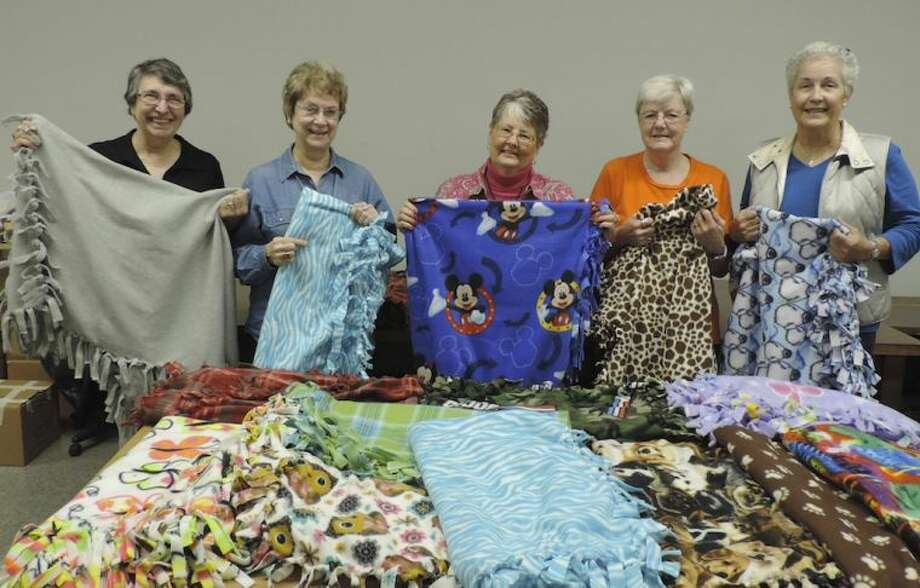 Members of the Lost Arts Club are shown with fleece blankets they have made for the Buckner Children's Village in Beaumont. Pictured left to right are Ann Barry, Rita Aalund, Deanna Stewart, Pat Craig and June Damek. Member Betty Boyd was not available for the photo. Photo: Submitted Photo
