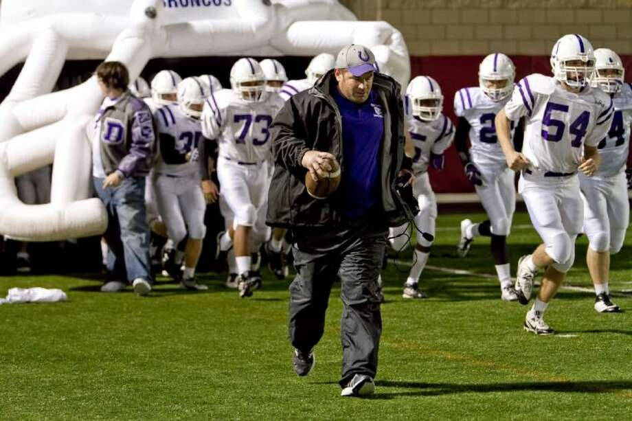 Head coach Jowell Hancock takes the field with his Dayton Broncos in their second playoff game of the 2013 season. Photo: AMANDA JORDAN