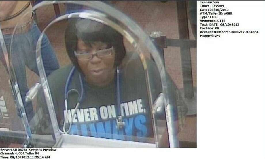 Surveillance footage of Joycelyn Dearmon, who is being sought by authorities for forging checks belonging to an 89-year-old Fort Bend man under her charge as a caregiver. Photo: Courtesy FBCSO