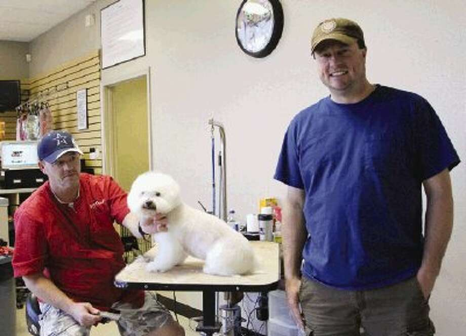 Danny Digges, a groomer, and Todd Kana, Magnolia mayor and owner of K-9 Design, pose for a photo Tuesday in Conroe. / The Conroe Courier