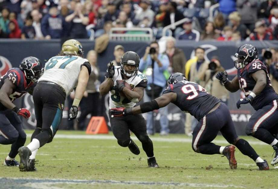 Jaguars running back Maurice Jones-Drew gets away from the Texans' Antonio Smith. The Jaguars won 13-6, the Texans' ninth straight loss.