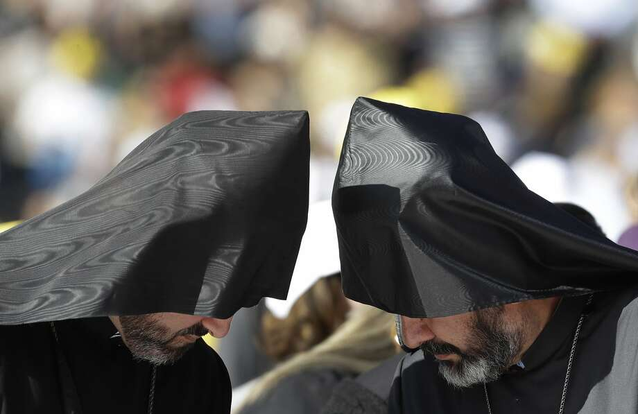 Orthodox priests wait for Pope Francis to arrive for a Mass in a stadium in Tbilisi, Georgia. The patriarchate decided at the last minute not to send an official delegation to the Mass. Photo: Alessandra Tarantino, Associated Press