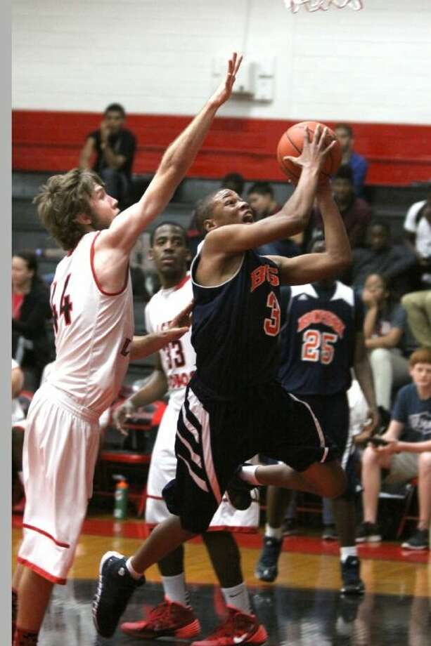Bush's Brendon Ganaway drives to the basket against Langham Creek's Spencer Stone during the 2013 McDonald's Texas Invitational Basketball Tournament in Pasadena. The Broncos won Pool H and are three wins from repeating as FBISD Tournament champions. Photo: Staff Photo By Alan Warren