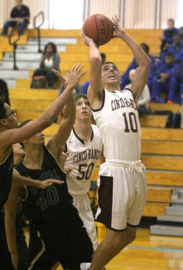 Cinco Ranch's Ben Sonnefeld puts up shot against Pasadena Memorial's Jeremy McCoy during a pool play game at the McDonald's Texas Invitational Basketball Tournament in Pasadena. To view or purchase this photo and others like it, go to HCNPics.com. Photo: Alan Warren
