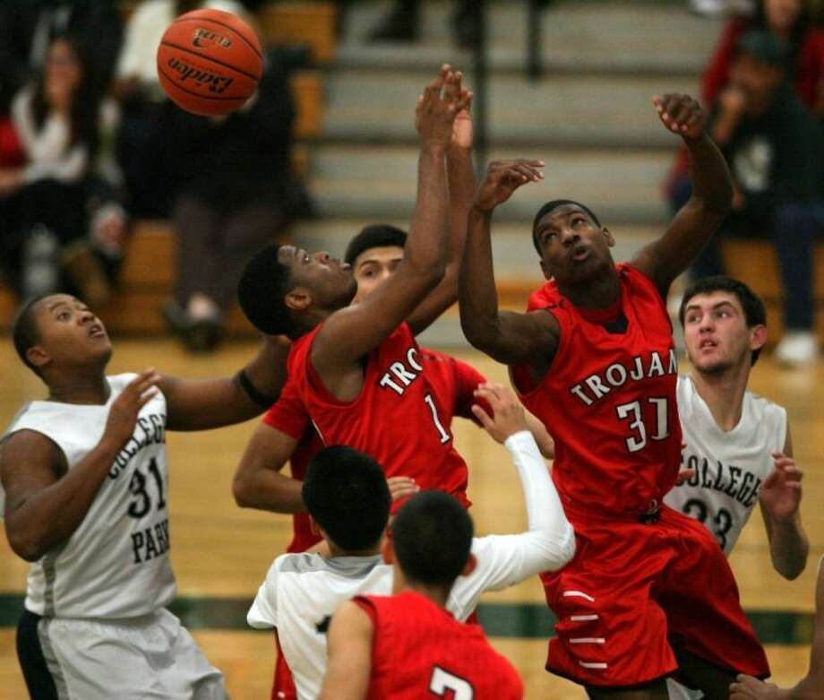 James Davis (31) and other South Houston teammates vie for a rebound against College Park in the third-place game for the Division 2 Gold Bracket of the 11th annual Texas Invitational. Photo: Kar Hlava