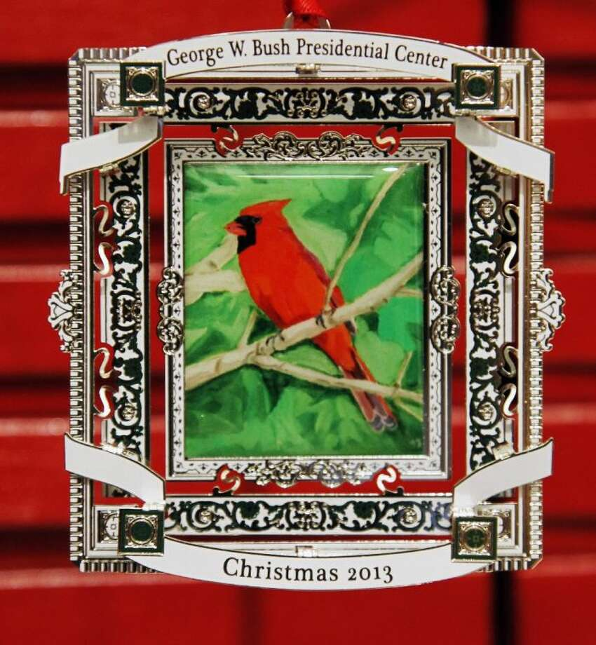 This Nov. 21, 2013 photo shows a 2013 commemorative Christmas ornament of a cardinal that Former President George W. Bush painted in Dallas, Texas. The ornament is now for sale at the Bush Presidential Center.