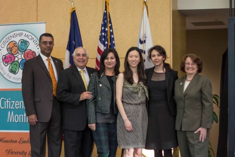 From left to right, Lone Star College-University Park President Shah Ardalan, University of Houston-Downtown President, Bill Flores, artist Saida Fagal, artist Jin Young Oh, curator Karine Parker-Lemoyne and Kathy Hubbard, celebrate the unveiling of art door at the Opening the Door to Citizenship event held at LSC-University Park on Tuesday, Nov. 19. Photo: Community Report