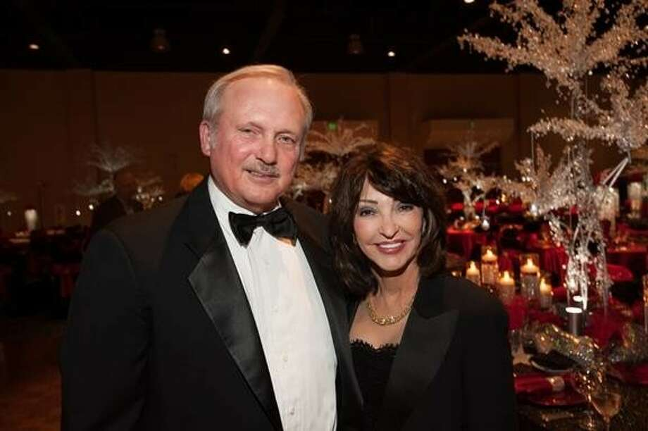 Glenn and Judy Smith were the honorees at the 15th annual Jeans & Jewels gala on Saturday, Oct. 19. The event raised more than $830,000 for Northwest Assistance Ministries. Photo: Alexander's Fine Portrait Design