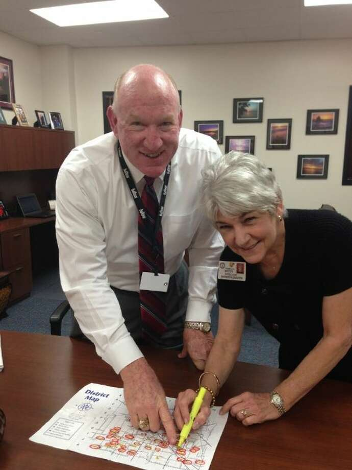 Pam Scott and Ralph Funk mark Jersey Village High School off Scott's District Map of adopted schools. Photo: Submitted Photo