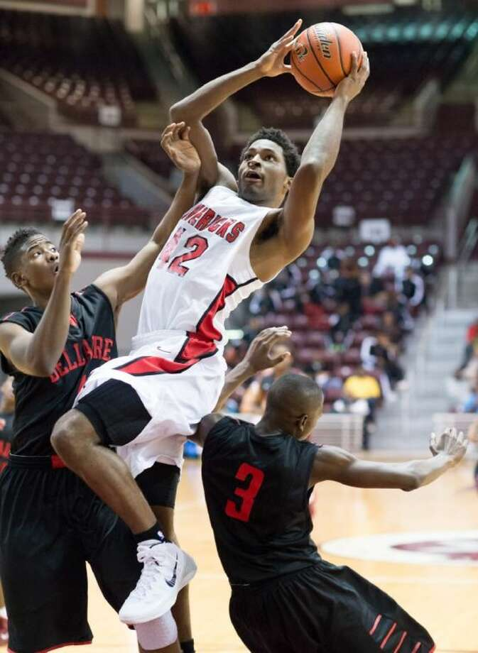 St. John's forward Justice Winslow, shown here earlier this season in action against 5A Bellaire, has signed a letter-of-intent to play college basketball at Duke. Winslow and the Mavericks are looking for a fourth consecutive trip to the Southwest Preparatory Conference championship game as they have made it to the SPC finals every year since Winslow was a freshman and played with his brother Josh. Photo: Kevin B Long