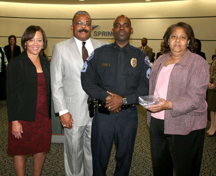 Spring ISD Police Officer Sgt. Dwendol Bryant, third from left, is joined by Spring ISD Associate Superintendent Regina Boutte, from left, Police Chief Victor Mitchell and Board President Justine Durant during a recognition ceremony at the November Board of Trustees meeting honoring him for being selected 2012-13 Spring ISD Police Department Supervisor of the Year.