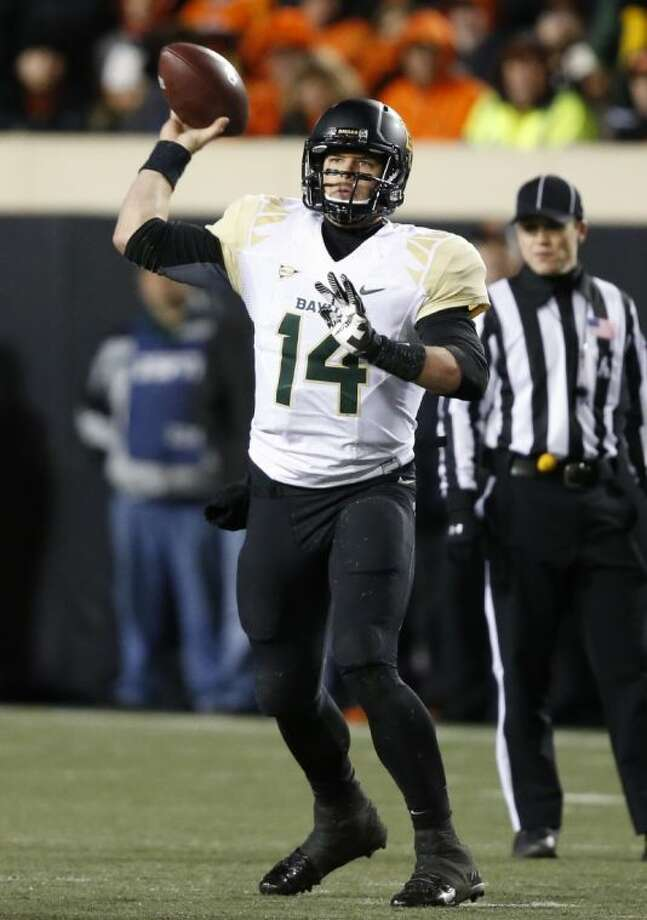 Baylor quarterback Bryce Petty, and Texas A&M's Johnny Manziel, right, were among the leading contenders for the Heisman Trophy before decisive losses over the weekend.