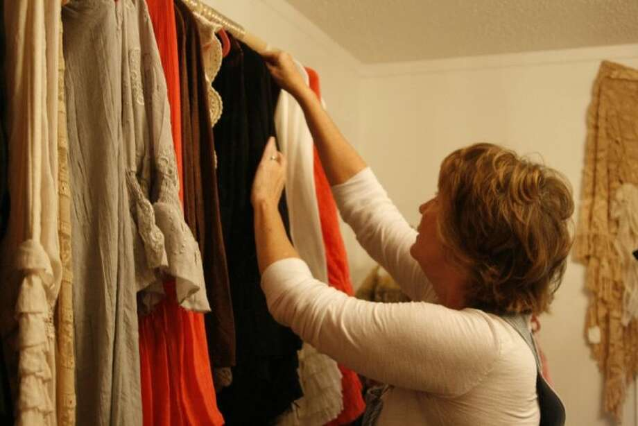 LaQueta Neal, owner of Petticoat Junktion in Huffman, straightens her boutique items.