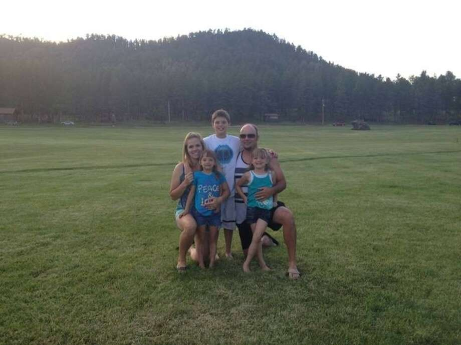 Andrea Morris became inspired to write her new children's book after traveling with her husband Matthew and three kids in the Big Horn Mountains of Wyoming. Left to right: Andrea, Kiera, Landon, Matthew, and Braelyn. Photo taken at the Big Horn Mountains. Photo: Submitted