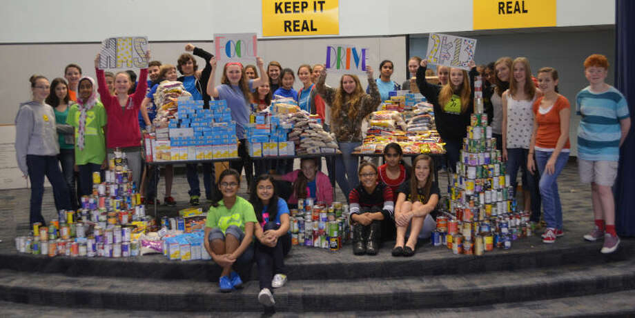 Hamilton Middle School students celebrate the results of their Thanksgiving food drive, which resulted in more than 1,000 pounds of food that was donated to Cy-Hope.