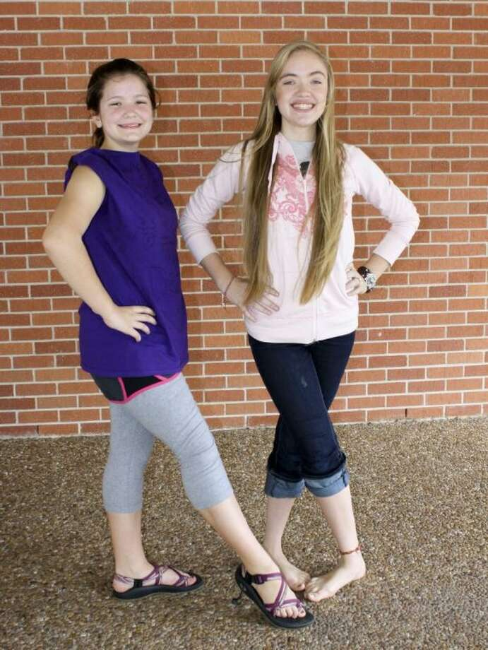 "Irish Step Dancers (and sisters) Emma, 12, and Abby, 16, Stewart take a break from teaching folk dances to their fellow Revels Houston cast members at a recent rehearsal for ""The 2013 Christmas Revels: An Irish Celebration of the Winter Solstice,"" presented Dec. 13-15 at the Edwin Hornberger Conference Center, 2151 W. Holcombe Blvd. For tickets or information, visit www.revelshouston.org or call 713-668-3303. Photo: Submitted"